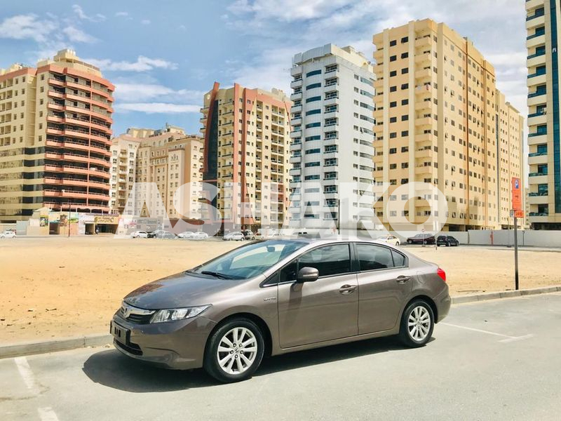 A Clean And Well Maintained HONDA CIVIC 2012 Brown GCC Mid Option With Allow Wheel  Cruise Cont